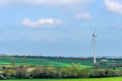 Wind Turbines and Blue Sky with Clouds over UK fields Stock Photography