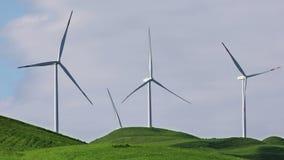Wind turbines with blue sky. On farm field stock video