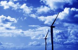 Wind turbines blue tint Royalty Free Stock Photography
