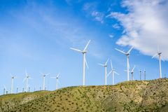 Wind turbines, California. Blue sky background royalty free stock photography