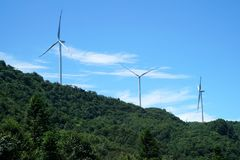 Wind Turbines In China. Wind turbines is working under the blue sky.It provides clean electronics power. It`s taken in Chongqing, China Royalty Free Stock Photo