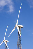 Wind turbines for clean energy. Wind turbines generating clean alternative energy Royalty Free Stock Images