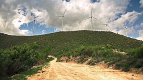 Wind turbines clean energy, protection of nature. Green grass on the hill stock video