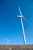 Wind turbines on clear blue sky Royalty Free Stock Image