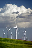 Wind Turbines and Clouds. Stark White Electrical Power Generating Wind Turbines on Rolling Wheat Covered Hills, Contrasted by Old Ranch Water Pumping Windmill Stock Image