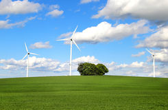 Wind turbines and cloudy blue sky Royalty Free Stock Image