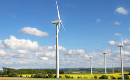 Wind turbines and cloudy blue sky Royalty Free Stock Images
