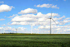 Wind turbines and cloudy blue sky Stock Image