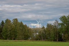 Wind turbines, converting the wind`s kinetic energy into electrical energy - ecologically clean source of energy. Wind turbines, converting the wind`s kinetic royalty free stock photos