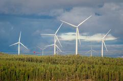 Wind turbines, converting the wind`s kinetic energy into electrical energy - ecologically clean source of energy. Wind turbines, converting the wind`s kinetic stock image