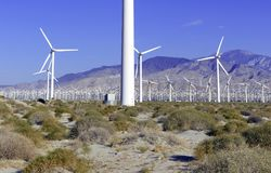 Wind turbines creating renewable energy on windfarm Royalty Free Stock Images