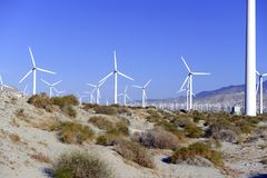 Wind turbines creating renewable energy on windfarm Royalty Free Stock Photos