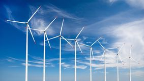 Wind turbines. 3d render of wind turbines on sky background Stock Images