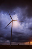 Wind turbines with a dark sky Stock Photography
