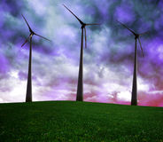 Wind turbines in dark storm clouds. Royalty Free Stock Photography