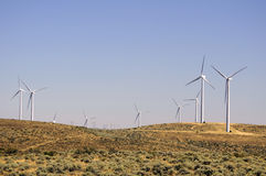 Wind turbines in a desert area Royalty Free Stock Photos