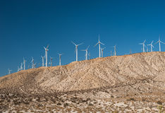 Wind turbines in desert landscape Stock Photo