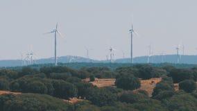 Wind Turbines in the Desert of Spain. Massive wind turbines generating power. Heat haze effect on desert land. Clean Energy producing of Windmills. Alternative stock video