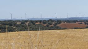 Wind Turbines in the Desert of Spain. Massive wind turbines generating power. Heat haze effect on desert land. Clean Energy producing of Windmills. Alternative stock video footage