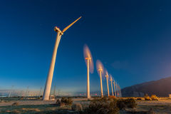 Wind Turbines in desert during sunrise time Stock Photos