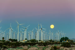 Wind Turbines in desert during sunrise time Stock Images
