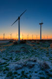 Wind Turbines in desert during sunrise time Royalty Free Stock Photos