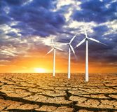 Wind turbines in a dry land Stock Photo