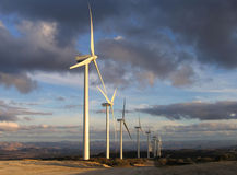 Wind turbines at dusk. In San Diego County back country Stock Photography