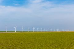 Wind turbines in Dutch farmland Royalty Free Stock Image