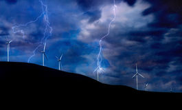 Wind Turbines on Electric Storm. Windmill Turbines Generating Electricity during a Thunder Storm Stock Images