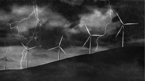 Wind Turbines on Electric Storm. Windmill Turbines Generating Electricity during a Thunder Storm Royalty Free Stock Image