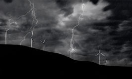 Wind Turbines on Electric Storm. Windmill Turbines Generating Electricity during a Thunder Storm Stock Photo