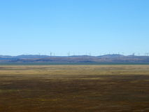 Wind turbines for electricity at lake george, act Stock Images