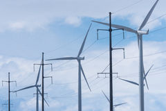 Wind Turbines with Electricity Power Pylons Stock Images
