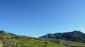 Wind turbines energy towers moving in the mountains stock footage