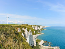 Wind turbines on english channel shore in Normandy Stock Photography