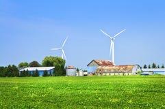 Wind turbines on farm. Green alternative clean power wind turbines on farm Royalty Free Stock Image
