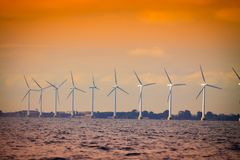 Wind turbines farm in Baltic Sea, Denmark. Wind turbines generator farm for renewable sustainable and alternative energy production along coast baltic sea near Stock Photos