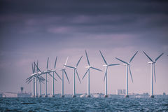 Wind turbines farm in Baltic Sea, Denmark. Vertical axis wind turbines generator farm for renewable sustainable and alternative energy production along coast Royalty Free Stock Photos