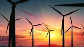 Wind turbines farm at beautiful orange sunset. Ecologic energy generators on beautiful sunny mountain landsape. Green