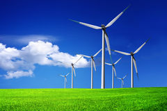 Wind turbines farm on blue sky Royalty Free Stock Image
