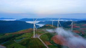 Wind turbines farm clean green energy for electric this is aerial view flying from Drone royalty free stock images