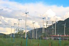 Wind turbines on a farm Stock Photos
