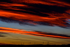 Wind Turbines Farm In The Distance On Beautiful Red, Orange And Blue Sunset Royalty Free Stock Images
