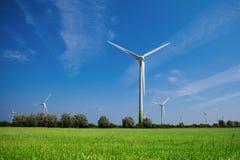 Wind turbines in farm field Royalty Free Stock Photo