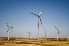 Wind turbines farm in field Stock Photography