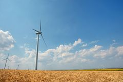 Wind turbines farm on field Stock Photo