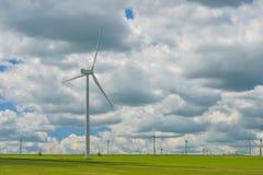 Wind turbines farm in the fields Stock Image