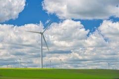 Wind turbines farm in the fields Royalty Free Stock Photo