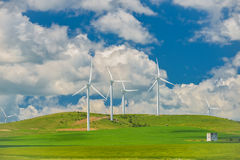 Wind turbines farm in the fields Stock Photo